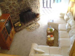living room and fireplace of 4 bedroom condo for rent in crested butte colorado