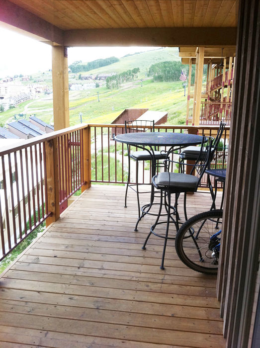 crested butte condo deck with tables and chairs
